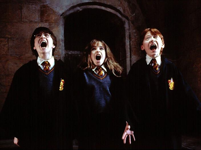"Daniel Radcliffe, Emma Watson, and Rupert Grint in ""Harry Potter and the Sorcerer's Stone."""