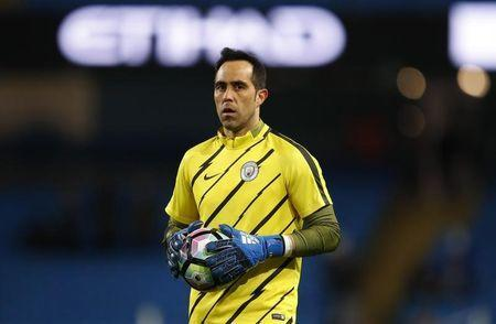 Britain Football Soccer - Manchester City v Stoke City - Premier League - Etihad Stadium - 8/3/17 Manchester City's Claudio Bravo warms up before the match. Reuters / Phil Noble Livepic