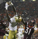 Notre Dame wide receiver Kevin Austin Jr. (4) catches a two-point conversion pass in front of Virginia Tech defensive back Nasir Peoples (31) during the second half of an NCAA college football game in Blacksburg, Va., Saturday, Oct. 9, 2021. (AP Photo/Matt Gentry)
