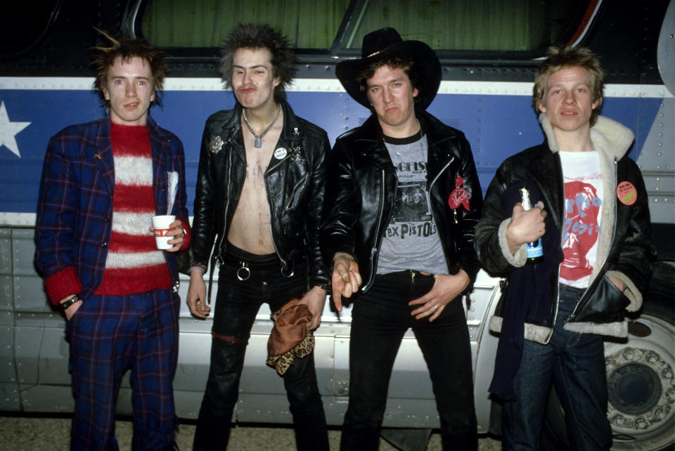 UNITED STATES - JANUARY 01:  USA  Photo of Steve JONES and SEX PISTOLS and Johnny ROTTEN and Sid VICIOUS, Johnny Rotten (John Lydon), Sid Vicious, Steve Jones & Paul Cook, posed, group shot, next to the tourbus, on final tour  (Photo by Richard E. Aaron/Redferns)