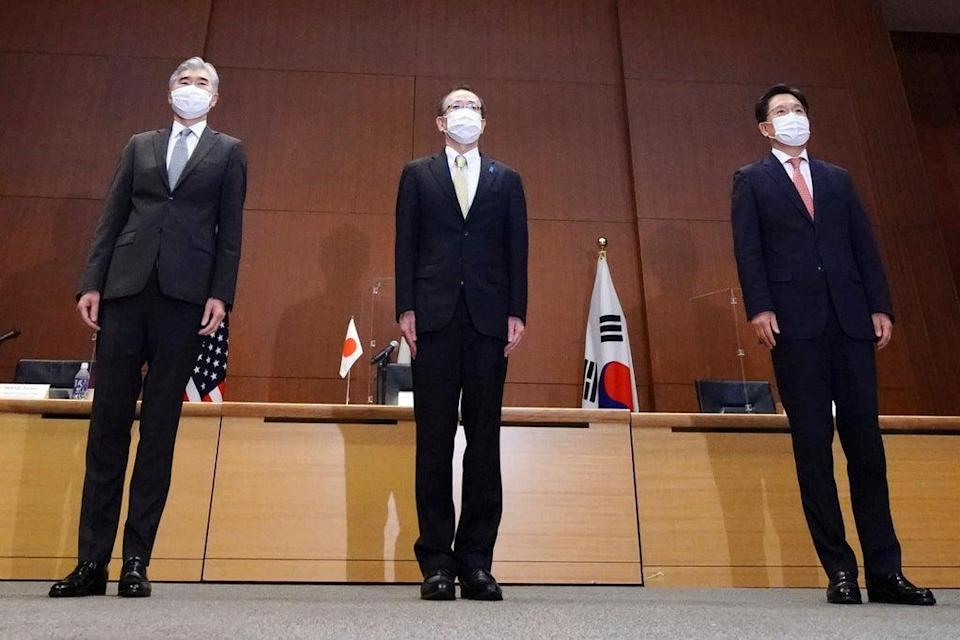 Top Japan, centre, US, left and South Korea's, right, diplomat hold talks in Tokyo  (AP)