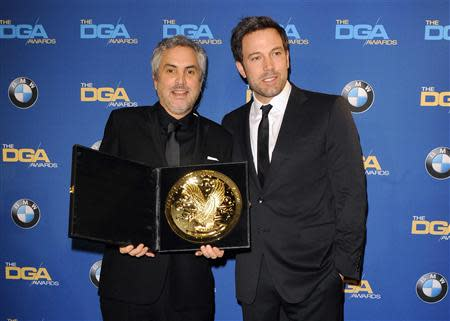 """Ben Affleck presents Mexican director Alfonso Cuaron with the Feature Film award for """"Gravity"""" during the 66th annual Directors Guild of America Awards in Beverly Hills"""