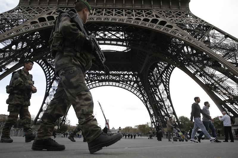 French soldiers patrol the Eiffel Tower in Paris, on November 16, 2015
