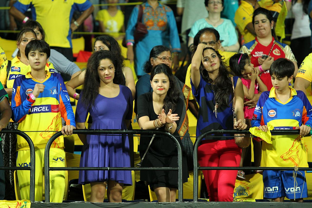 Sakshi Dhoni claps after CSK won league match against the Royal Challengers Bangalore held at the MA Chidambaram Stadiumin Chennai on the 13th April 2013. Joining Sakshi was her friend, fashion designer Masaba Gupta. Photo by Prashant Bhoot-IPL-SPORTZPICS