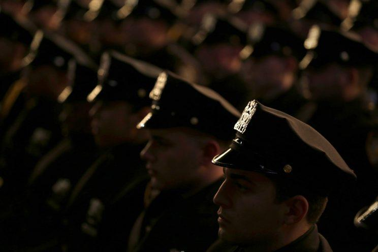 New graduates of the NYPD Police Academy participate in a graduation ceremony in New York, Wednesday, Dec. 28, 2016. The ceremony celebrated 555 new officers who just completed their 6 months training. (Photo: Seth Wenig/AP)