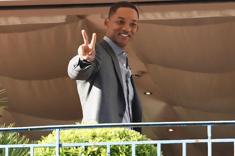 US actor Will Smith has jumped to Netflix's defence in the row over the future of cinema at the Cannes film festival (AFP Photo/Anne-Christine POUJOULAT            )