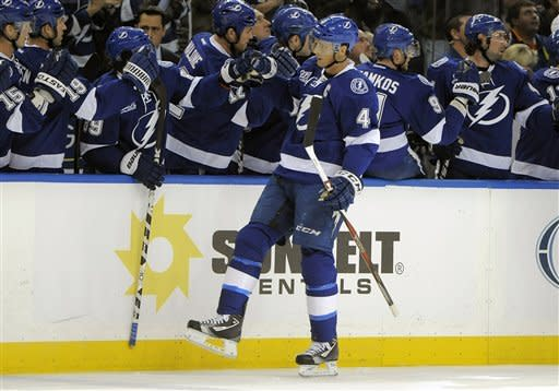 Tampa Bay Lightning center Vincent Lecavalier (4) celebrates with his bench following his goal during the first period of an NHL hockey game against the Washington Capitals Saturday, Jan. 19, 2013, in Tampa, Fla. (AP Photo/Brian Blanco)