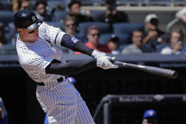 New York Yankees' Aaron Judge connects for a two-run home run against the Toronto Blue Jays during the third inning of a baseball game, Saturday, April 21, 2018, in New York. (AP Photo/Julie Jacobson)