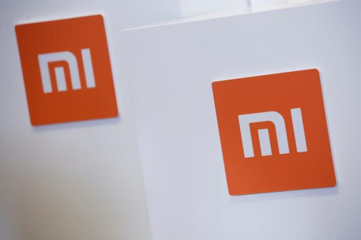 FILE PHOTO: Xiaomi logos are displayed during a news conference in Hong Kong