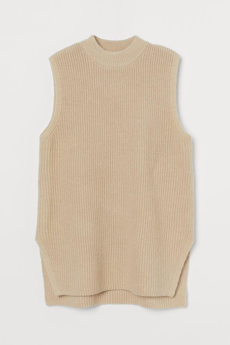 <p>Wear this <span>Rib-knit Sweater Vest</span> ($30) over a long-sleeve cardigan for a polished work-ready look.</p>