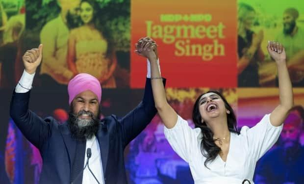 NDP Leader Jagmeet Singh and his wife, Gurkiran Kaur Sidhu, arrive on stage Monday to address supporters at his election night headquarters in Vancouver during the 2021 Canadian federal election. (Jonathan Hayward/Canadian Press - image credit)
