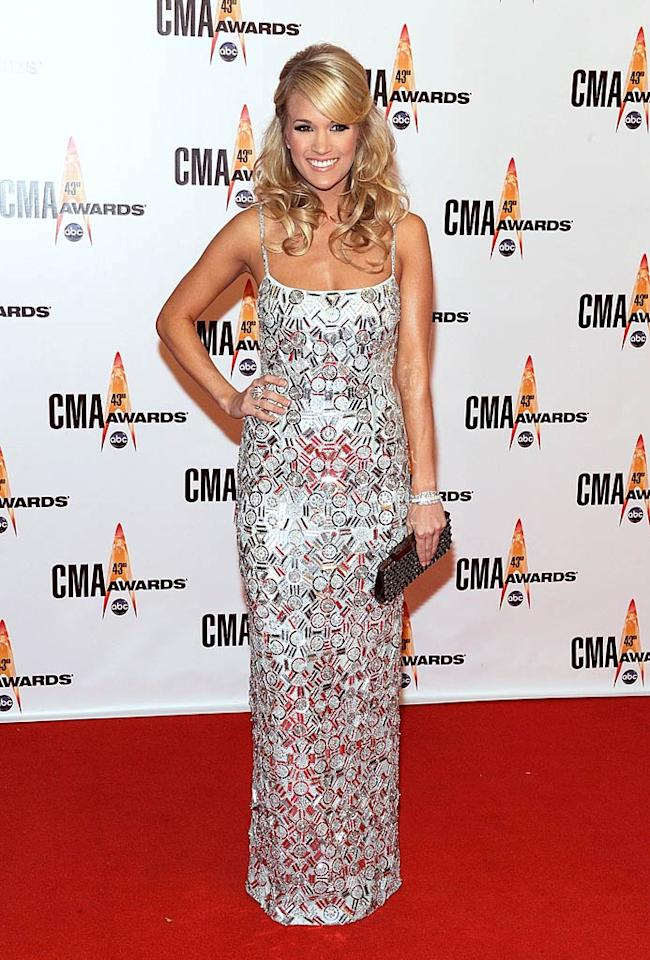 "Carrie Underwood  Grade: A+  The blond bombshell reigned supreme in a spaghetti-strapped sparkler at the 43rd annual CMA Awards in Nashville, Tennessee. Frederick Breedon/<a href=""http://www.gettyimages.com/"" target=""new"">GettyImages.com</a> - November 11, 2009"