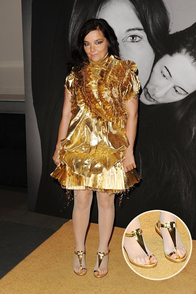 "In her worst fashion faux pas since the infamous swan dress debacle at the 2001 Academy Awards, Icelandic singer Bjork sported this ruffled Givenchy wreck, along with holey hose (that showed off her big toes!) at a recent art exhibit in NYC. Stephen Lovekin/<a href=""http://www.gettyimages.com/"" target=""new"">GettyImages.com</a> - June 1, 2010"
