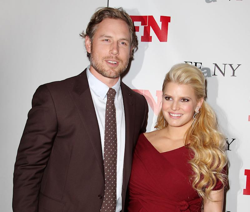 FILE - In this Nov. 29, 2011 file photo, singer Jessica Simpson, right, poses with her fiance Eric Johnson at the 25th Annual Footwear News Achievement Awards at The Museum of Modern Art in New York. A publicist for the singer confirmed Simpson gave birth to a daughter named Maxwell Drew Johnson in Los Angeles on Tuesday, May 1. Maxwell weighed 9 lbs. 13 ounces, said publicist Lauren Auslander. It's the first child for 31-year-old Simpson and her 32-year-old fiance Eric Johnson, a former NFL player.  (AP Photo/Starpix, Amanda Schwab, file)