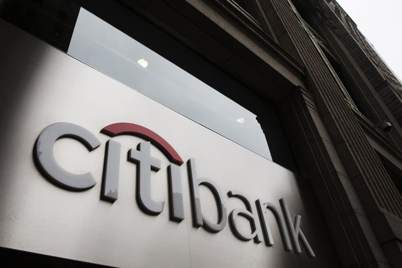 The Citibank logo is seen at the facade of a Citibank building in New York