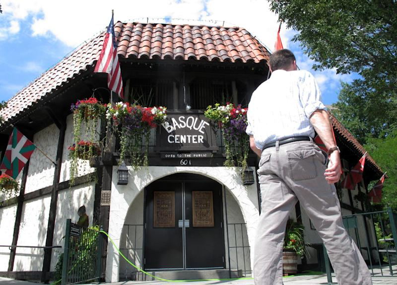 In this Aug. 7, 2013 photo, a man walks in front of the Basque Center in Boise, Idaho. The Basque Center is a gathering place for Boise's Basque community and one of several stops in the city's downtown Basque Block. The city's Basque Block downtown is the best place for learning more about the heritage. As early the late 1800s, Basques began settling in southwestern Idaho, many lured here to work as sheepherders. The Basque Block includes a museum, a market, restaurants, street art and historical signage. (AP Photo/Todd Dvorak)