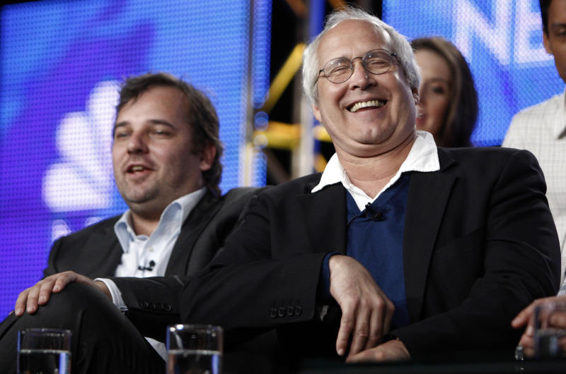 "FILE - This Aug. 5, 2009 file photo shows actor Chevy Chase, right, laughs as executive producer and creator Dan Harmon looks on during the panel for ""Community"" at the NBC Universal Television Critics Association summer press tour in Pasadena, Calif. NBC said Monday, June 10, 2013, that show creator Dan Harmon will be joined by another former ""Community"" producer, Chris McKenna.Harmon was replaced as showrunner for season four after a clash with then-cast member Chevy Chase. (AP Photo/Matt Sayles, file)"