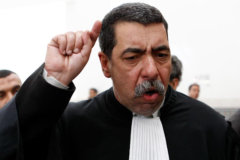 """Larbi Chentoufi, Mouad Belghouat's lawyer  gestures at the court  during the case of Mouad Belghouat, the Moroccan rapper, also known as El-Haqed, or """"the enraged"""", in Casabalnce Wednesday April 4, 2012.   A Moroccan court denied bail on Wednesday to a rapper charged with attacking the image of the security services in a song about police corruption. Mouad Belghouat was arrested March 29 after Morocco's National Security agency filed a suit against him, and he is now being tried for insulting state employees and official institutions, a charge that could lead to a prison sentence. (AP Photo/Abdeljalil Bounhar)"""