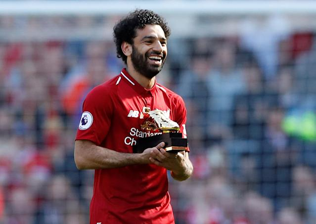 "Soccer Football - Premier League - Liverpool vs Brighton & Hove Albion - Anfield, Liverpool, Britain - May 13, 2018 Liverpool's Mohamed Salah celebrates with the Golden Boot after the match Action Images via Reuters/Carl Recine EDITORIAL USE ONLY. No use with unauthorized audio, video, data, fixture lists, club/league logos or ""live"" services. Online in-match use limited to 75 images, no video emulation. No use in betting, games or single club/league/player publications. Please contact your account representative for further details."