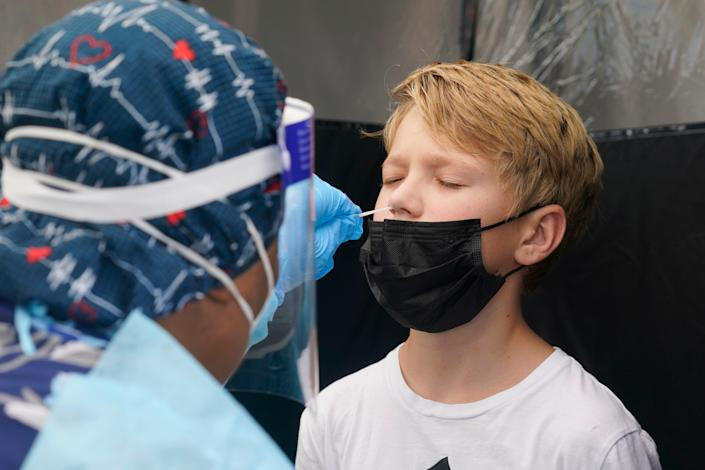 A boy in Miami receives a Covid test on 9 August, 2021.  (AP)