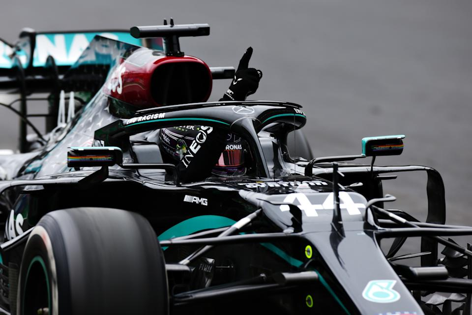 <em>Lewis Hamilton celebrates after taking the checkered flag in the No. 44 Mercedes AMG Petronas for his record 92nd victory in Formula One (Peter Fox/Getty Images).</em>