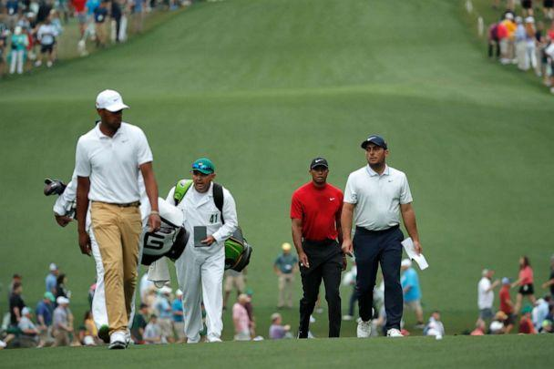 PHOTO: Francesco Molinari, Tiger Woods and Tony Finau walk up the first fairway during final round play at the Masters in Augusta, Ga., April 14, 2019. (Mike Segar/REUTERS)