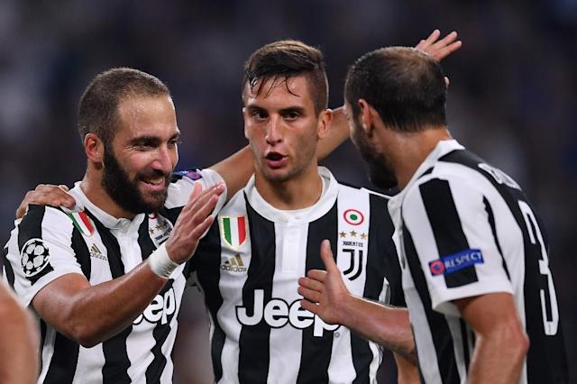 (From L) Juventus' Gonzalo Higuain, Rodrigo Bentancur and Giorgio Chiellini celebrate a goal during their UEFA Champion's League Group D match against Olympiacos, at the Juventus stadium in Turin, on September 27, 2017 (AFP Photo/Marco BERTORELLO)