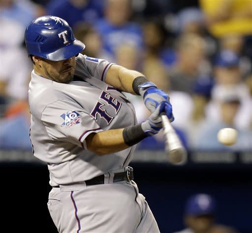 Texas Rangers' Geovany Soto hits an RBI double during the seventh inning of a baseball game against the Kansas City Royals, Thursday, Sept. 6, 2012, in Kansas City, Mo. (AP Photo/Charlie Riedel)