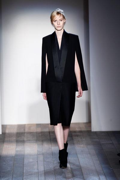 <b>Victoria Beckham AW13 at New York Fashion Week </b><br><br>The androgynous trend was a key look on VB's catwalk as a model stepped out in this oversized tuxedo blazer.<br><br>Image © Getty