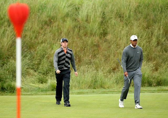 ARDMORE, PA - JUNE 14: Rory McIlroy of Northern Ireland and Tiger Woods of the United States walk onto the 17th green during a continuation of Round One of the 113th U.S. Open at Merion Golf Club on June 14, 2013 in Ardmore, Pennsylvania. (Photo by Andrew Redington/Getty Images)