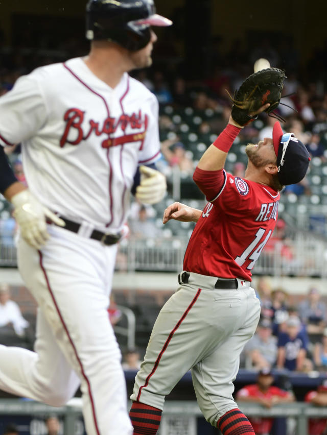 Washington Nationals first baseman Mark Reynolds catches a pop fly hit by Atlanta Braves' Lucas Duda, left, during the eighth inning of a baseball game Saturday, Sept. 15, 2018, in Atlanta. Washington won 7-1. (AP Photo/John Amis)