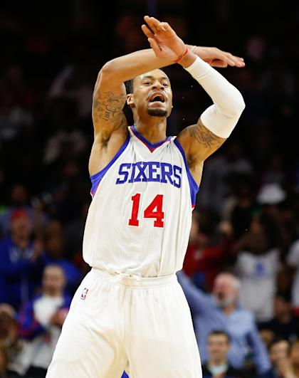 Nov 29, 2014; Philadelphia, PA, USA; Philadelphia 76ers guard K.J. McDaniels (14) reacts to a score against the Dallas Mavericks during the third quarter at Wells Fargo Center. The Mavericks defeated the 76ers 110-103. (Bill Streicher-USA TODAY Sports)