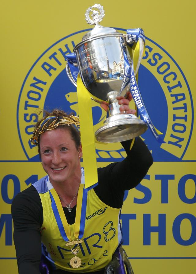 Tatyana McFadden, of the U.S. holds the trophy after winning the women's wheelchair division at the 118th running of the Boston Marathon in Boston