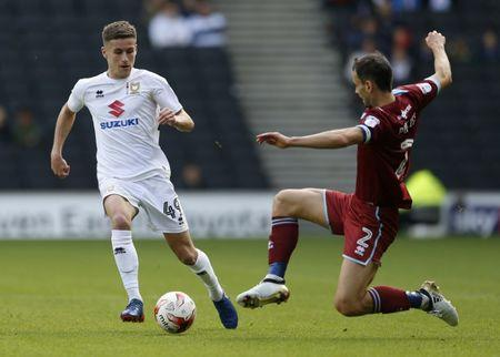 Football Soccer Britain - Milton Keynes Dons v Port Vale - Sky Bet League One - Stadium MK - 9/10/16 MK Dons? Ryan Colclough in action with Port Vale's Ben Purkiss Mandatory Credit: Action Images / Andrew Boyers Livepic