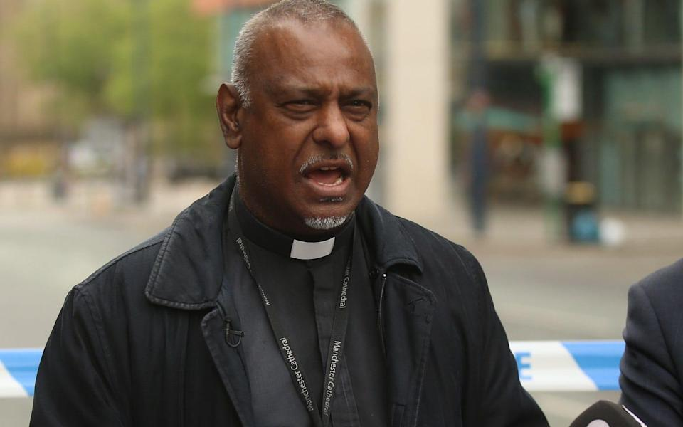 Dean of Manchester, The Very Reverend Rogers Govender, says prayers for the victims - Credit: SWNS