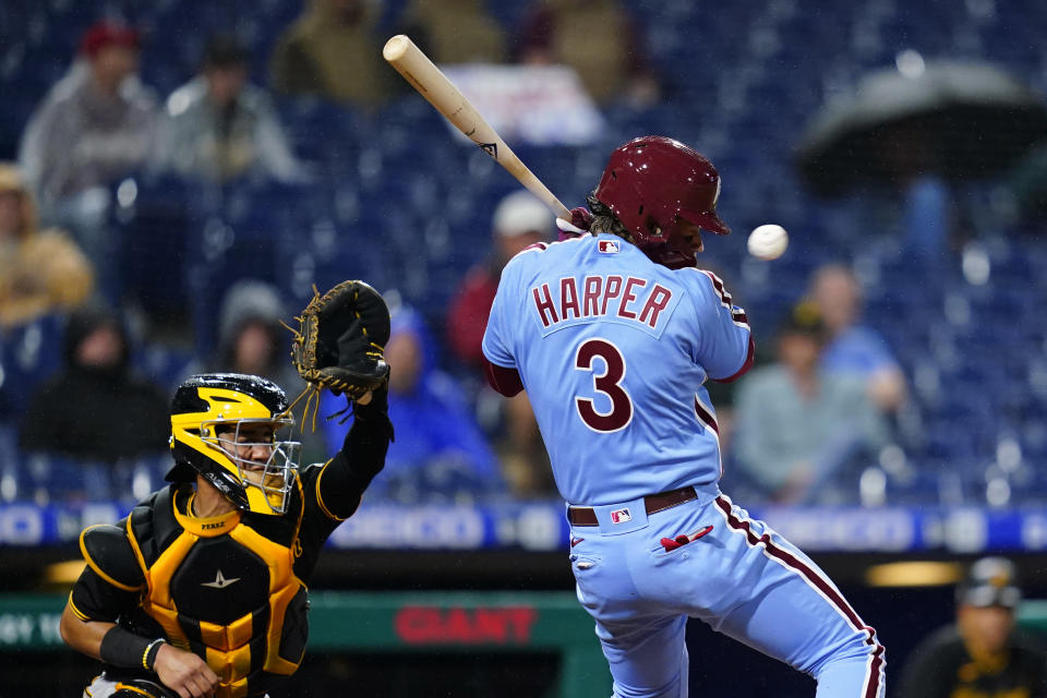 Philadelphia Phillies' Bryce Harper avoids a pitch from Pittsburgh Pirates' Anthony Banda during the fifth inning of a baseball game, Thursday, Sept. 23, 2021, in Philadelphia. (AP Photo/Matt Slocum)