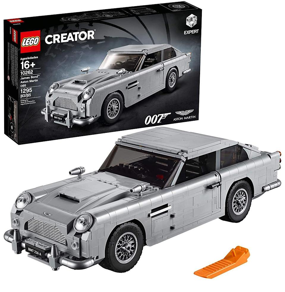 """<p><strong>LEGO Creator</strong></p><p>amazon.com</p><p><strong>$179.99</strong></p><p><a href=""""https://www.amazon.com/dp/B07FQ3KF2B?tag=syn-yahoo-20&ascsubtag=%5Bartid%7C10054.g.34039580%5Bsrc%7Cyahoo-us"""" rel=""""nofollow noopener"""" target=""""_blank"""" data-ylk=""""slk:Buy"""" class=""""link rapid-noclick-resp"""">Buy</a></p><p>The most iconic car to ever be filmed, Bond's Aston Martin DB5, laden with gadgetry, first appeared in <em>Goldfinger</em>. Recreated in Lego form, it has all the same bells and whistles, down to the ejector seat. </p>"""