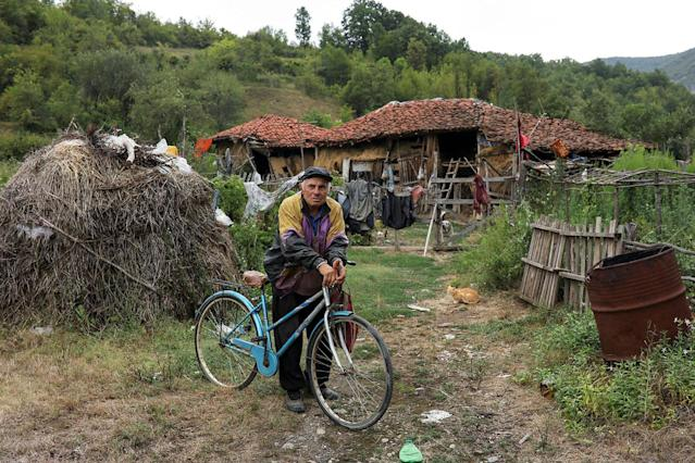 <p>A man holds his bicycle in front of his home in the village of Gornja Kamenica, near the southeastern town of Knjazevac, Serbia, Aug. 14, 2017. (Photo: Marko Djurica/Reuters) </p>