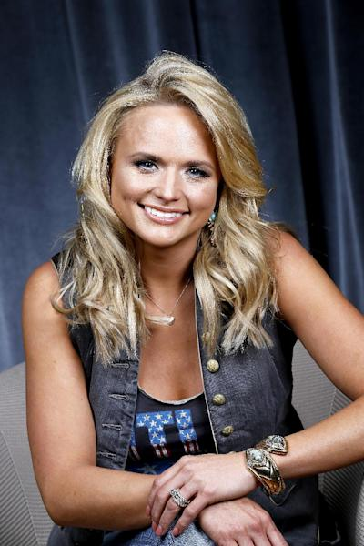 "This Feb. 24, 2014 photo shows singer Miranda Lambert in Nashville, Tenn. Lambert will release her fifth album, ""Platinum,"" on June 3. (Photo by Donn Jones/Invision/AP)"