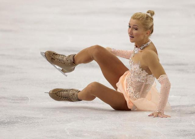 Aliona Savchenko falls as she and Robin Szolkowy of Germany compete in the pairs free skate figure skating competition at the Iceberg Skating Palace during the 2014 Winter Olympics, Wednesday, Feb. 12, 2014, in Sochi, Russia. (AP Photo/Ivan Sekretarev)