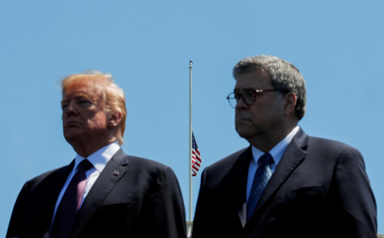 U.S. President Donald Trump and U.S. Attorney General William Barr attend the 38th Annual National Peace Officers Memorial Service on Capitol Hill in Washington, U.S., May 15, 2019. REUTERS/Carlos Barria     TPX IMAGES OF THE DAY
