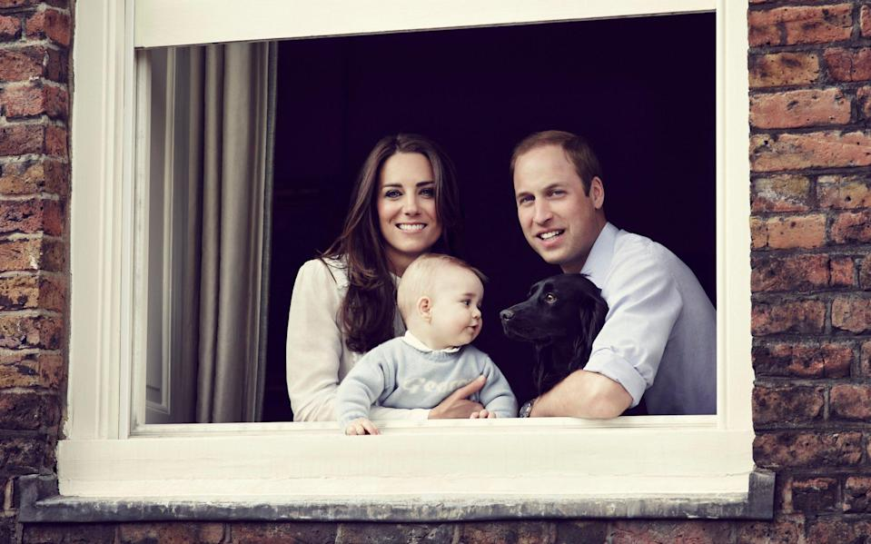 The Cambridges with Prince George and Lupo, pictured in March 2014