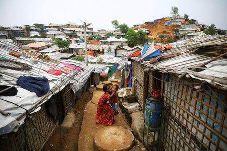 FILE PHOTO: Rohingya children are seen at a refugee camp in Cox's Bazar, Bangladesh, March 7, 2019. REUTERS/Mohammad Ponir Hossain/File Photo