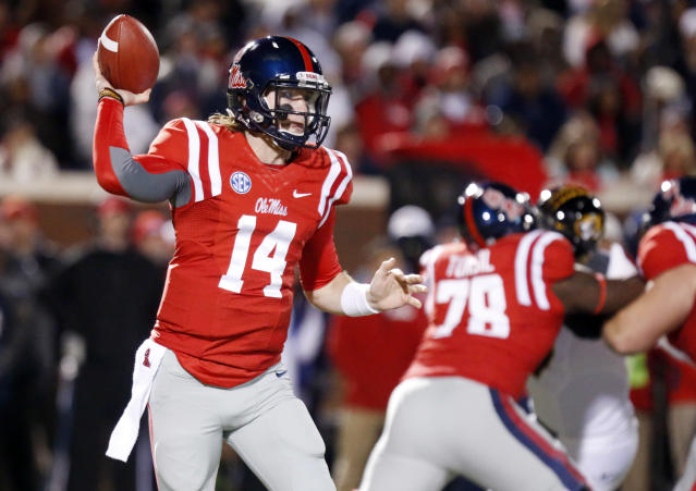 Mississippi quarterback Bo Wallace (14) prepares to pass against Missouri during the first half of an NCAA college football game, Saturday, Nov. 23, 2013, in Oxford, Miss. No. 8 Missouri won 24-10. (AP Photo/Rogelio V. Solis)
