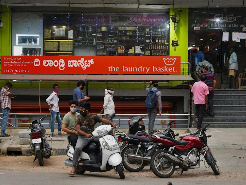 People line-up outside a Bangalore liquor store to make a last minute purchase ahead of a new lockdown: AFP via Getty Images