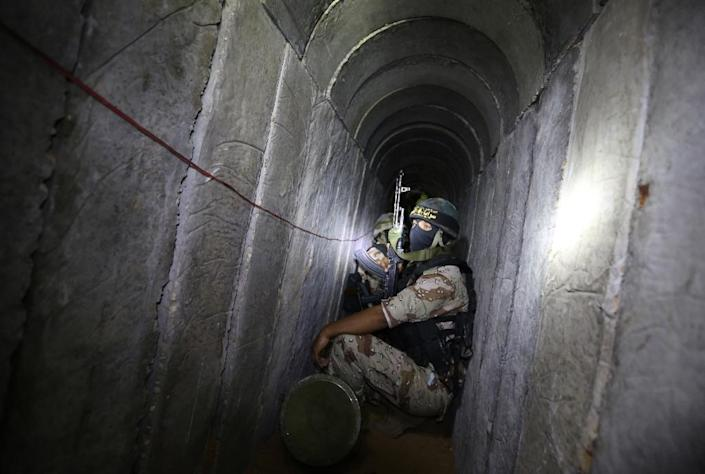 The tunnels under Israel's border with Gaza can be used to store weapons, while fighters have also used them to conduct raids into Israel (AFP Photo/Mahmud Hams)