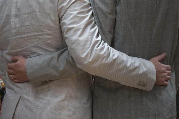 Scott Everhart and Jason Welker hold each other before exchanging wedding vows at a comic book retail shop in Manhattan, New York June 20, 2012.