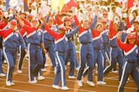 """<p>Let's get physical! In 1984, Team USA suited up in patriotic sweatsuits with a matching red visor. The athletic uniforms were courtesy of Levi Strauss, who actually put several styles up for a vote. The people spoke (in true American fashion), asking for """"active"""" uniforms (also in true American fashion).</p>"""