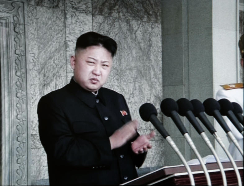 In this image made from KRT video, North Korean leader Kim Jong Un claps before giving his first public speech during a massive celebration marking the 100th birthday of national founder Kim Il Sung, Sunday, April 15, 2012, at Kim Il Sung Square, in Pyongyang, North Korea. Kim praised his grandfather, as tens of thousands gathered in Pyongyang's main square for meticulously choreographed festivities that came two days after a failed rocket launch. (AP Photo/KRT via AP video) NORTH KOREA OUT, TV OUT