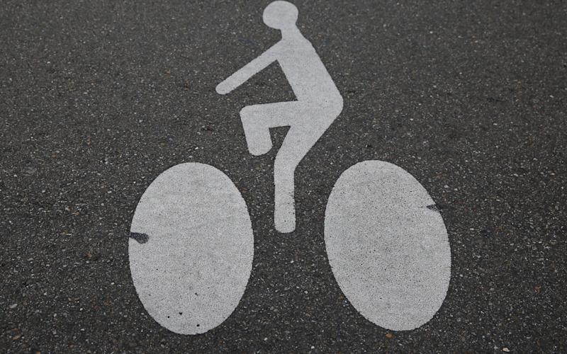 Sign representing a cyclist is painted on a cycling path in downtown Strasbourg - REUTERS
